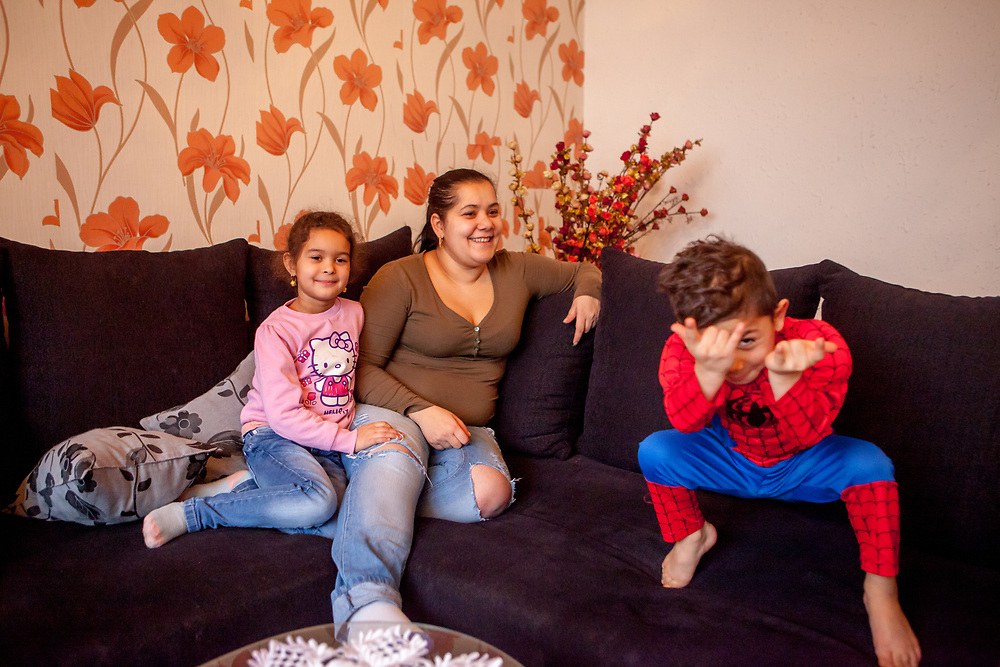 Family portrait with Jitka Cervenakova (25) who is the mother of Sarlota Kroscen (6) and Sebastian Kroscen (4), dressed as spiderman. Jitka is also a volunteer supporting other mothers with knowledge and explaining legal rights for getting their children into mainstream schools in the city of Ostrava, where Roma and non Roma children are educated together.