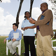 Owen Shumba from the UNDP's Bureau of Conflict Prevention and Recovery addresses project beneficiaries at Giwa Resettlement Farm as his colleague Fabrizio Andreuzzi (left) and UNDP Disaster Risk Reduction and Recovery (Kenya) Team Leader Beatrice Teya (centre) look on. Near Nakuru, Rift Valley Province, Kenya.