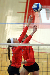 28 September 2014:  Kaitlyn Early and Emily Schneider during an NCAA womens volleyball match between the Evansville Purple Aces and the Illinois State Redbirds at Redbird Arena in Normal IL