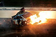 Aric Almirola (43) crashes into Danica Patrick (10) and Joey Logano (22) during the NASCAR Monster Cup auto race at Kansas Speedway in Kansas City, Kan., Saturday, May 13, 2017. (AP Photo/Colin E. Braley)