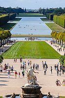 The Palace of Versailles, or simply Versailles, is a royal château close to Paris, France. The Gardens of Versailles with the Bassin de Latone. Apollo Fountain in Bassin d'Apollon and Grand Canal in the background.