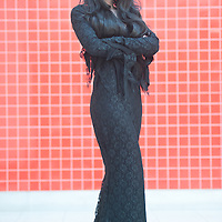 London, UK - 26 May 2013: Laura Benson dressed as Morticia Addams of the Addams Family poses for a picture during the London Comic Con 2013 at Excel London. London Comic Con is the UK's largest event dedicated to pop culture attracting thousands of artists, celebrities and fans of comic books, animes and movie memorabilia.