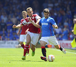Bristol City's Liam Kelly battles for the ball with Glasgow Rangers' Richard Foster - Photo mandatory by-line: Joe Meredith/JMP - Tel: Mobile: 07966 386802 13/07/2013 - SPORT - FOOTBALL - Bristol -  Bristol City v Glasgow Rangers - Pre Season Friendly - Bristol - Ashton Gate Stadium