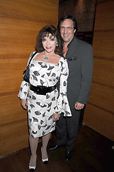 """JOAN COLLINS and PERCY GIBSON at a party and exclusive private view of 'Naked Portrait With Reflection"""" by Lucian Freud hosted by Christie's held at 17 Berkeley Street, London on 17th June 2008.<br /><br />NON EXCLUSIVE - WORLD RIGHTS"""