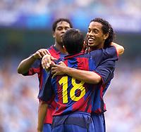 Photo. Jed Wee<br /> Manchester City v Barcelona, Pre-season Friendly, City of Manchester Stadium, Manchester. 10/08/2003.<br /> Barcelona's Ronaldinho (R) celebrates with the goalscorer Saviola.