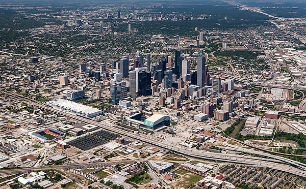 Aerial view of downtown Houston in May 2013 featuring BBVA Compass Stadium, Minute Maid Park, George R. Brown Convention Center, and Toyota Center.