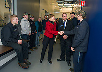 Senator Jeanne Shaheen shakes student Bryan Conover's hand during a tour of the LRCC Automotive Technology Bldg at the Lakes Region Workforce Development Resource Summit Friday morning. (l-r) Students Will Bickford, Josiah Grace, Ben LeBreton, Senator Jeanne Shaheen, Asst Professor Jamie Decato, Cody Walker and Bryan Conover.   (Karen Bobotas/for the Laconia Daily Sun)