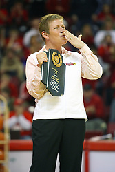 """31 January 2009: Missouri Valley Commissioner Doug Elgin presented Molly Arnold with the conferences Most Courageous Award.  Molly battle cancer.  Molly blows a kiss of appreciation to the crowd. The Illinois State University Redbirds join the Bradley Braves in a tie for 2nd place in """"The Valley"""" with a 69-65 win on Doug Collins Court inside Redbird Arena on the campus of Illinois State University in Normal Illinois"""