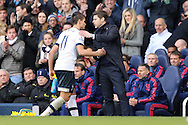 Mauricio Pochettino, the Tottenham Hotspur manager congratulates Erik Lamela of Tottenham Hotspur as the Spurs player is subbed off. Barclays Premier league match, Tottenham Hotspur v Manchester Utd at White Hart Lane in London on Sunday 10th April 2016.<br /> pic by John Patrick Fletcher, Andrew Orchard sports photography.