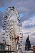 Europa Rad, 55 meters high ferris wheel in the Rheinau harbor at the Chocolate Museum, the cathedral, Cologne, Germany.<br /> <br /> Europa Rad, 55 Meter hohes Riesenrad m Rheinauhafen am Schokoladenmuseum, der Dom, Koeln, Deutschland.