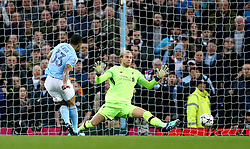 Manchester City's Gabriel Jesus (left) scores his side's first goal of the game during the UEFA Champions League, Quarter Final at the Etihad Stadium, Manchester.