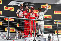 October 21, 2018 - Austin, TX, U.S. - AUSTIN, TX - OCTOBER 21: Winning drivers and Ferrari pit crew chief wave to fans during celebration following the F1 United States Grand Prix on October 21, 2018, at Circuit of the Americas in Austin, TX. (Photo by John Crouch/Icon Sportswire) (Credit Image: © John Crouch/Icon SMI via ZUMA Press)
