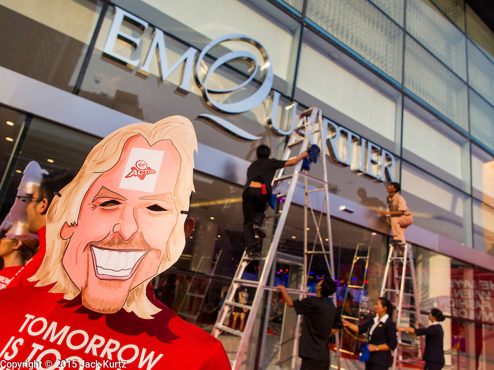 """27 MARCH 2015 - BANGKOK, THAILAND: A Richard Branson cut out figure promoting a Virgin health club in """"EmQuartier,"""" a  new shopping mall in Bangkok. """"EmQuartier"""" is across Sukhumvit Rd from Emporium. Both malls have the same corporate owner, The Mall Group, which reportedly spent 20Billion Thai Baht (about $600 million US) on the new mall and renovating the existing Emporium. EmQuartier and Emporium have about 450,000 square meters of retail, several hotels, numerous restaurants, movie theaters and the largest man made waterfall in Southeast Asia. EmQuartier celebrated its grand opening Friday, March 27.    PHOTO BY JACK KURTZ"""