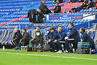 Football - 2020 / 2021 Sky Bet Championship - Cardiff City vs Middlesbrough - Cardiff City Stadium<br /> <br /> BORO & Cardiff bench take the knee without Middlesborough manager Neil Warnock on his return to Cardiff City who arrived after<br /> in a match played without fans<br /> <br /> COLORSPORT
