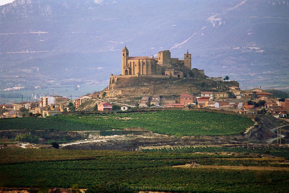 Hilltop town of San Vincente de la Sonsierra dominated by its castle, before sunrise. Rioja, Spain.