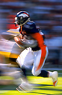 Clinton Portis of the Denver Broncos rushes upfield at Invesco Field in Denver, CO