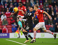 Blackburn Rovers' Danny Graham under pressure from Barnsley's Marc Roberts, right, is tackled by Barnsley's Andy Yiadom<br /> <br /> Photographer Chris Vaughan/CameraSport<br /> <br /> The EFL Sky Bet Championship - Barnsley v Blackburn Rovers - Monday 26th December 2016 - Oakwell Stadium - Barnsley<br /> <br /> World Copyright © 2016 CameraSport. All rights reserved. 43 Linden Ave. Countesthorpe. Leicester. England. LE8 5PG - Tel: +44 (0) 116 277 4147 - admin@camerasport.com - www.camerasport.com
