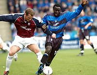 SPORTSBEAT 01494 783165<br /> PICTURE ADY KERRY .<br /> GILLINGHAM VS IPSWICH TOWN<br /> GILLINGHAM'S PATRICK AGYEMANG CHALLENGES WITH IPSWICH'S JIM MAGILTON, 17TH APRIL 2004.