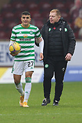 Mohamed Elyounoussi (Celtic) and Neil Lennon (Celtic) during the Scottish Premiership match between Motherwell and Celtic at Fir Park, Motherwell, Scotland on 8 November 2020.