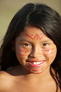 School child of the Pemon peoples, an Amerindian tribe, performing at a dance at Uruyen village, Canaima National Park, Venezuela