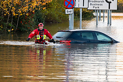 South Yorkshire flooding. Ickles Roundabout Rotherham. Specialist rescue teams from the West Midlands Fire service checking partially submerged vehicles as they rescue people from vehicles and business premises along the A6178 Sheffield Rd<br /> <br />  Copyright Paul David Drabble<br />  07 November 2019<br />  www.pauldaviddrabble.co.uk
