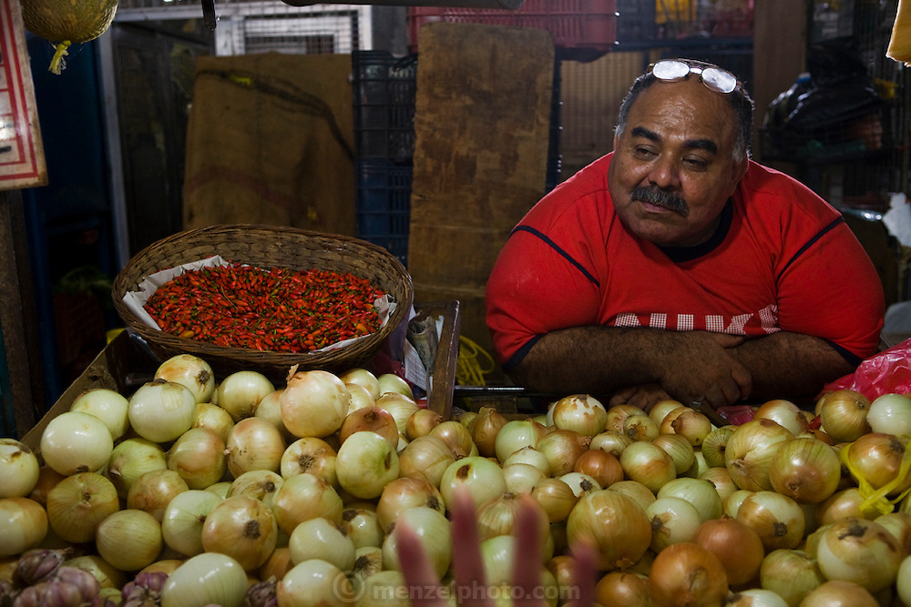 Vendor selling onions at Mercado Quinta Crespo, Caracas, Venezuela.
