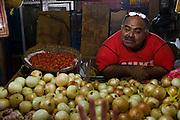 Vendor selling onions at Mercado Quinta Crespo, Caracas, Venezuela.
