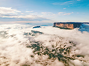 The magnificent Mount Roraima towers above the clouds hanging over the Gran Sabana in Venezuela