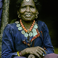 NEPAL, Himalaya. A woman in the Marsyandi Valley below Annapurna wears her traditional jewelry, including gold nose and earrings, wrist bangles, and necklaces made from coral & silver Indian coins, all dating before 1920 -- probably inherited from her grandmother.