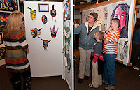 Nancy Trowsdale and her two sons Thomas and William admire the artwork on display from various schools during Arts Alive at the Belknap Mill Thursday evening.  Thomas, a 6th grader at Winnisquam Regional Middle School, has a bobble head snowboarder on display.  (Karen Bobotas/for the Laconia Daily Sun)
