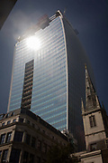 The intensive glare of solar rays reflected off the concave plate glass windows of one of the capital's newest skyscrapers known as the Walkie Talkie. The hotspot has surprised developers and passers-by below and which has already melted a parked car in Eastcheap Street. Thermometers placed in the street reached 144F (62 celcius) and city workers poured out of their offices at lunchtime to experience the intense light and heat.
