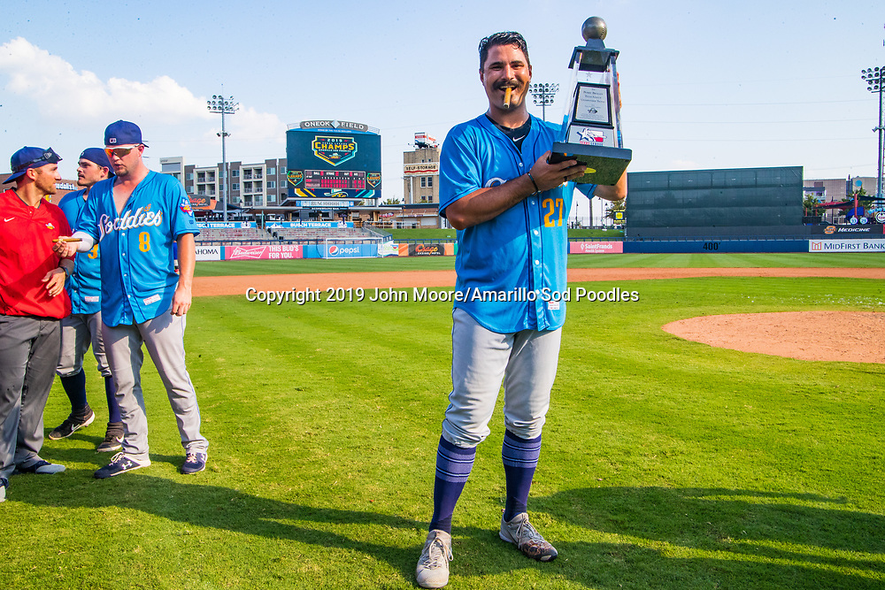 Amarillo Sod Poodles pitcher Travis Radke (27) poses with the trophy after the Sod Poodles won against the Tulsa Drillers during the Texas League Championship on Sunday, Sept. 15, 2019, at OneOK Field in Tulsa, Oklahoma. [Photo by John Moore/Amarillo Sod Poodles]