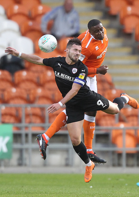 Blackpool's Donervon Daniels jumps with  Barnsley's Tom Bradshaw<br /> <br /> Photographer Mick Walker/CameraSport<br /> <br /> Carabao Cup First Round - Blackpool v Barnsley - Tuesday August 14th 2018 - Bloomfield Road - Blackpool<br />  <br /> World Copyright © 2018 CameraSport. All rights reserved. 43 Linden Ave. Countesthorpe. Leicester. England. LE8 5PG - Tel: +44 (0) 116 277 4147 - admin@camerasport.com - www.camerasport.com