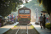 07 JANUARY 2013 - KANCHANABURI, THAILAND:    A passenger train pulls into the station at the Bridge on the River Kwai station in Kanchanburi, Thailand. Thailand has a very advanced rail system and trains reach all parts of the country.    PHOTO BY JACK KURTZ