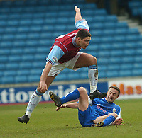 MILLWALL VS BURNLEY<br /> 28TH  FEBRUARY 2004<br /> DENNIS WISE FEELS THE FORCE OF A CHALLENGE FROM BRADLEY ORR<br /> Sportsbeat Images