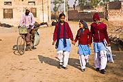 School girls heading to school, Chita Kalaan village, Punjab, India.