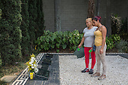 30/03/2016 - Medellin, Colombia: Irene Medina, 61 and Dayana Garcia, 25, visit and honor the grave of Pablo Escobar in Monte Sacro cemetery in Medellin. Even if he has done nad things, they also defend he did good things and protected the poor. That is why they visit the Escobar's grave when ever is possible. (Eduardo Leal)