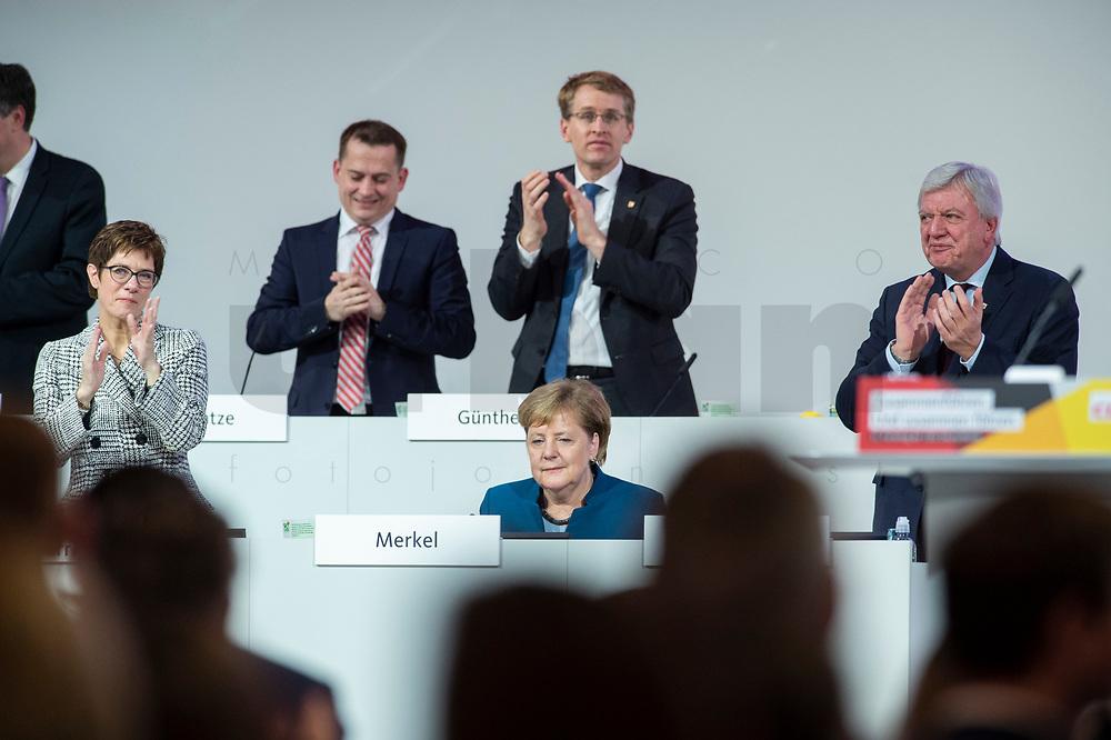 07 DEC 2018, HAMBURG/GERMANY:<br /> Angela Merkel, CDU, Bundeskanzlerin, nach Ihrer letzten Rede als Parteivorsitzende, unten links: Annegret Kramp-Karrenbauer, CDU Generalsekretaerin, unten rechts: Volker Bouvier, CDU, Ministerpraesident Hessen, hinten v.L.n.R.: Dr. Roland Heintze, CDU Landesvorsitzender Hamburg, Daniel Guenther, CDU, Ministerpraesident Schleswig-Holstein, CDU Bundesparteitag, Messe Hamburg<br /> IMAGE: 20181207-01-075<br /> KEYWORDS: party congress, Appluas, applaudiren, klatschen, Jubel, Daniel Günther