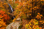 Magnificient waterfalls in a colorful autumn forest