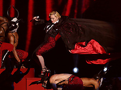 File photo dated 25/02/2015 of Madonna taking a stumble down stairs whilst performing on stage, during the 2015 Brit Awards at the O2 Arena, London. The pop superstar will celebrate her 60th birthday on Thursday, following a long career of reinvention and controversy.