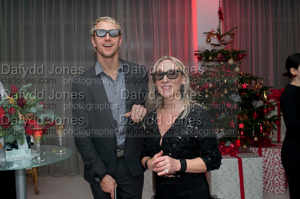 JUDY BROOKS; IAN WAITE WATCHING BALLET ON SKY TELEVISION USING 3 D GLASSES, , English National Ballet launches its Christmas season with a partyu before s performance of The Nutcracker at the Coliseum.  St. Martin's Lane Hotel.  London. 16 December 2009 *** Local Caption *** -DO NOT ARCHIVE-© Copyright Photograph by Dafydd Jones. 248 Clapham Rd. London SW9 0PZ. Tel 0207 820 0771. www.dafjones.com.<br /> JUDY BROOKS; IAN WAITE WATCHING BALLET ON SKY TELEVISION USING 3 D GLASSES, , English National Ballet launches its Christmas season with a partyu before s performance of The Nutcracker at the Coliseum.  St. Martin's Lane Hotel.  London. 16 December 2009