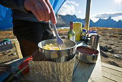 Camp activities during a hiking trip in Tombstone Territorial Park, Yukon in late summer