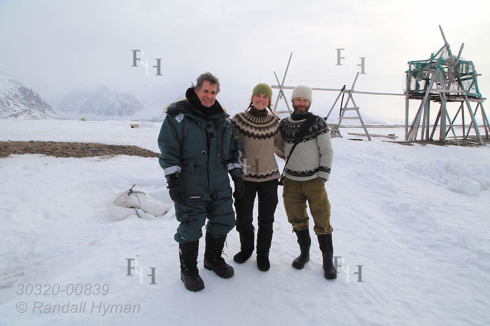 Visitor Randall Hyman poses with Ragnhild Røsseland and Frode Skar at trapper's hut site where they are living off the land for two years in remote Austfjorden in Svalbard, Norway.