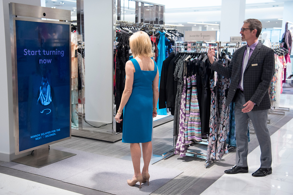 LuJo Churchill tries on a dress in front of a 360 degree video mirror at the newly opened Neiman Marcus store in Fort Worth, Texas on April 11, 2017. <br /> CREDIT: Cooper Neill for The Wall Street Journal<br /> NEIMAN