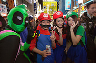 October 29, 2016, Tokyo, Japan: In the Shibuya district, the heart of Japanese youth culture, Halloween celebrations have exploded in the past few years. Up until this boom, Halloween celebrations were minimal across the city. But Shibuya has now become Halloween central with tens of thousands of costumed party goers invading it's streets to promenade en-costume or hit club events in the area. This informal street gathering has become so big, this year the Tokyo Metropolitan Police Dept. decided to close off two main streets adjacent to Shibuya Station. When Oct. 31 falls on a weekday, ninety percent of Halloween celebrations across Japan take place on the preceding Saturday. Pictured here are Super Mario Brothers costumes.(Torin Boyd/Polaris).