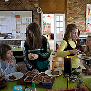 Toustrup Mark Community,  Sporup, Denmark, March 13, 2010. Girls in the dining room.