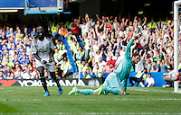 Swansea City's Bafetibis Gomis celebrates putting the ball in the back of the net, but the goal is disallowed for offside<br /> <br /> Photographer Craig Mercer/CameraSport<br /> <br /> Football - Barclays Premiership - Chelsea v Swansea City - Saturday 8th August 2015 - Stamford Bridge - London<br /> <br /> © CameraSport - 43 Linden Ave. Countesthorpe. Leicester. England. LE8 5PG - Tel: +44 (0) 116 277 4147 - admin@camerasport.com - www.camerasport.com