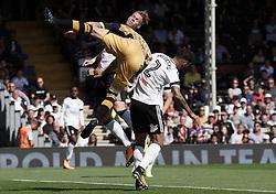 Sheffield Wednesday's Steven Fletcher (centre) and Fulham's Ryan Fredericks battle for the ball