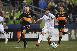 October 8, 2018 - Seattle, Washington, U.S - Seattle midfielder VICTOR RODRIGUEZ (8) gets pressure from Houston's ADAM LUNDQVIST (14) as the Houston Dynamo visits the Seattle Sounders in a MLS match at Century Link Field in Seattle, WA. Seattle won the match 4-1. (Credit Image: © Jeff Halstead/ZUMA Wire)