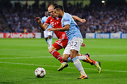 Bayern Forward Arjen Robben (NED) challenges Man City Defender Gael Clichy (FRA) during the second half of the match - Photo mandatory by-line: Rogan Thomson/JMP - Tel: Mobile: 07966 386802 - 02/10/2013 - SPORT - FOOTBALL - Etihad Stadium, Manchester - Manchester City v Bayern Munich - UEFA Champions League Group D.